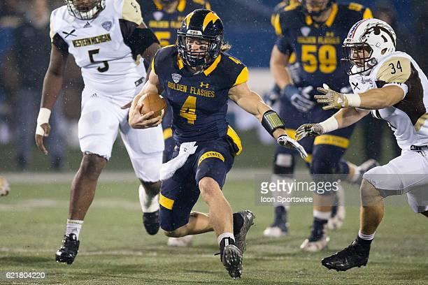 Kent State Golden Flashes QB Nick Holley carries the football during the first quarter of the NCAA Football game between the Western Michigan Broncos...