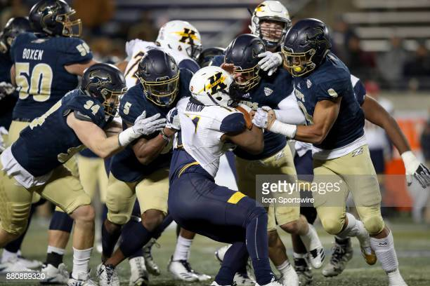 Kent State Golden Flashes running back Justin Rankin is stopped by the heart of the Akron defense during the third quarter of the college football...