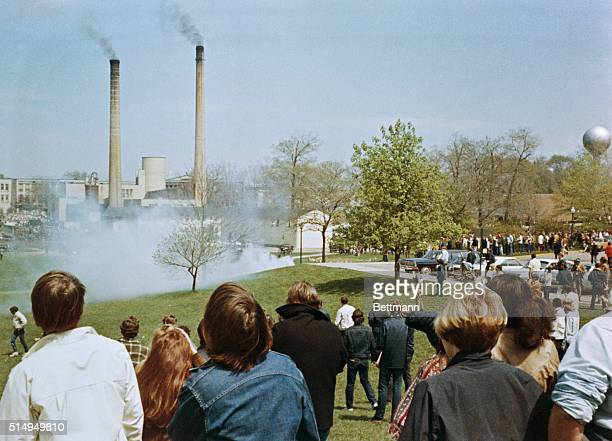 Kent State University students demonstrating against the US war in Vietnam and its expansion into South East Asia are confronted by tear gas of the...