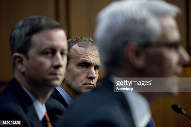 Kent Walker vice president and general counsel with Google Inc center and Sean Edgett acting general counsel with Twitter Inc left listen as Colin...
