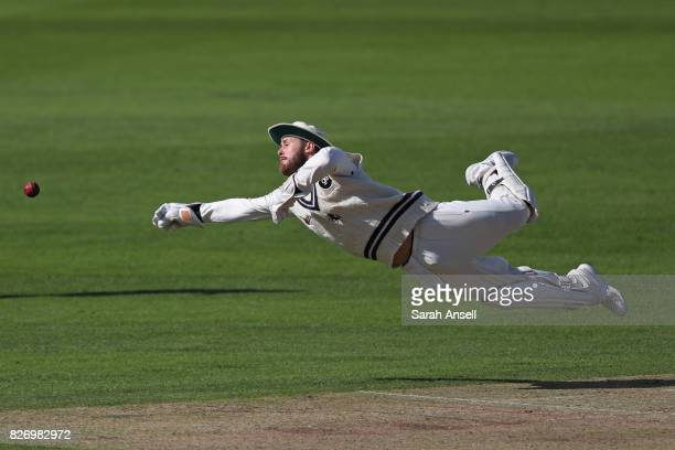 Kent wicket keeper Adam Rouse dives in an attempt to field the ball during day one of the tour match between Kent and West Indies at The Spitfire...