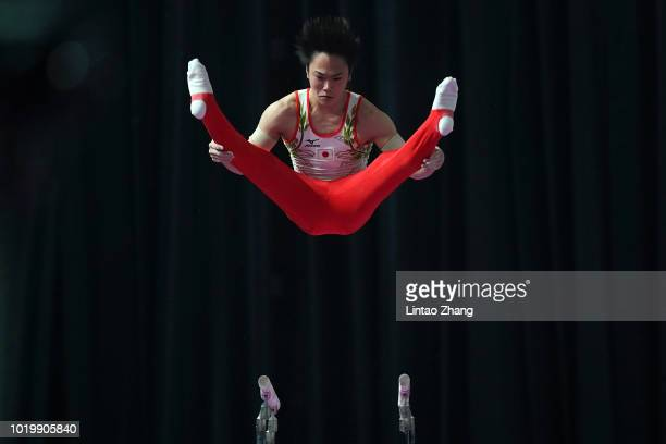 Zou Jingyuan of China competes on the Parallel Bars in qualification one of the artistic gymnastics event on day two of the Asian Games on August 20...