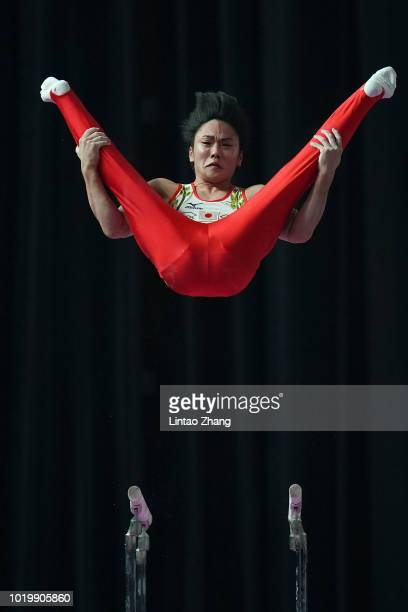 Kenta Chiba of Japan competes on the Parallel Bars in qualification one of the artistic gymnastics event on day two of the Asian Games on August 20,...