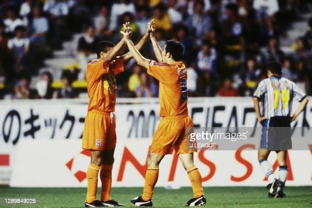 Kenta Hasegawa of Shimizu S-Pulse celebrates scoring a goal with his team mate Santos during the J.League first stage match between Avispa Fukuoka...