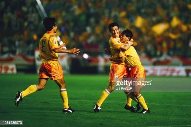 Kenta Hasegawa of Shimizu S-Pulse celebrates scoring his side's first goal with his team mates Takumi Horiike and Katsumi Oenoki during the J.League...