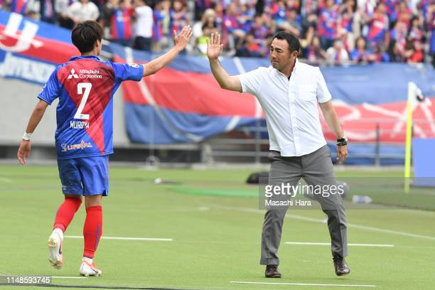 Kenta Hasegawa,coach of FC Tokyo and Sei Muroya high five during the J.League J1 match between FC Tokyo and Jubilo Iwata at Ajinomoto Stadium on May...