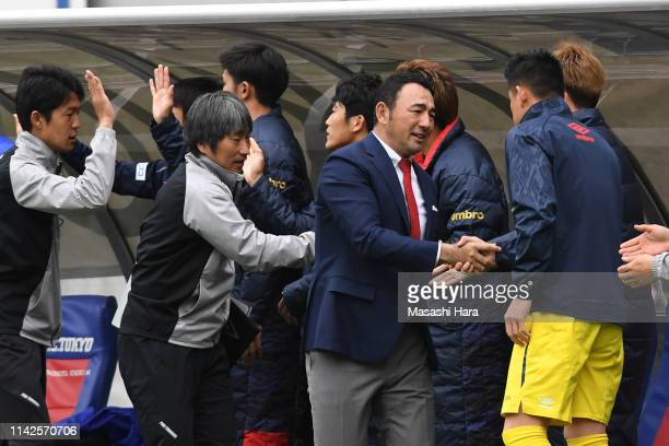 Kenta Hasegawa,coach of FC Tokyo celebrates the win during the J.League J1 match between FC Tokyo and Kashima Antlers at Ajinomoto Stadium on April...