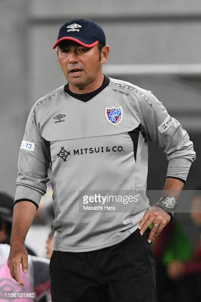 Kenta Hasegawa,coach of FC Tokyo looks on during the J.League J1 match between FC Tokyo and Vissel Kobe at Ajinomoto Stadium on June 15, 2019 in...