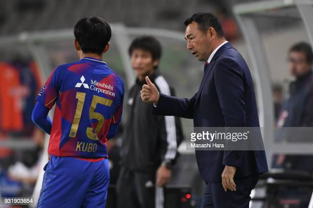 Kenta Hasegawacoach of FC Tokyo speaks to Takefusa Kubo during the JLeague YBC Levain Cup Group A match between FC Tokyo and Albirex Niigata at...