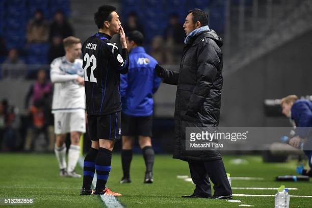 Kenta Hasegawa,coach of Gamba Osaka speaks during the AFC Champions League Group G match between Gamba Osaka and Melbourne Victory at Suita City...