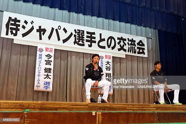 Kenta Imamiya and Shohei Otani of Samurai Japan visit a Naha school prior to the exhibition game between Samurai Japan and MLB All Stars at Okinawa...