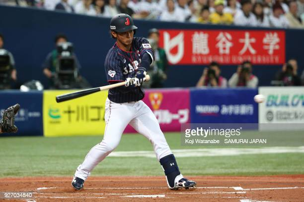 Kenta Imamiya of Japan hits a single in the top half of the second inning during the game two of the baseball international match between Japan and...