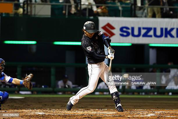 Kenta Imamiya of Samurai Japan hits a RBI single in the top half of the second inning during the exhibition game between Samurai Japan and MLB All...