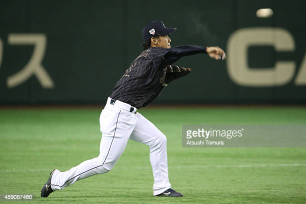 Kenta Imamiya of Samurai Japan throws a ball in the fifth inning during the game four of Samurai Japan and MLB All Stars at Tokyo Dome on November...
