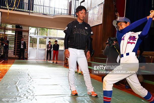 Kenta Imamiya of Samurai Japan visits a Naha school prior to the exhibition game between Samurai Japan and MLB All Stars at Okinawa Cellular Stadium...