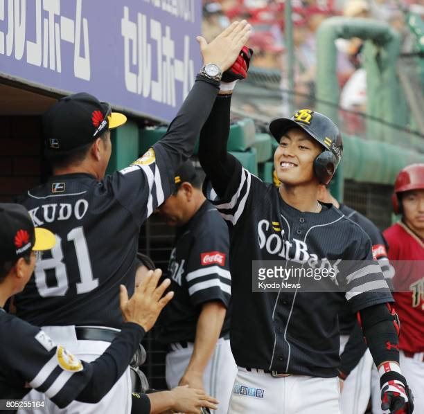Kenta Imamiya of the SoftBank Hawks celebrates with manager Kimiyasu Kudo after hitting a home run during the sixth inning of their 109 win over the...