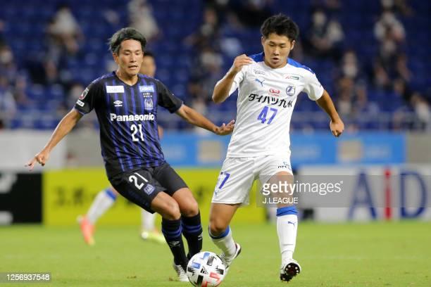 Kenta Inoue of Oita Trinita and Shinya Yajima of Gamba Osaka compete for the ball during the J.League Meiji Yasuda J1 match between Gamba Osaka and...