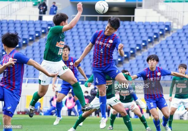 Kenta Itakura of Yamanashi Gakuin heads the ball during the 99th All Japan High School Soccer Tournament final between Yamanashi Gakuin and Aomori...