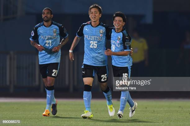 Kenta Kano and Tatsuya Hasegawa of Kawasaki Frontale celebrate their fourth goal during the AFC Champions League Round of 16 match between Kawasaki...