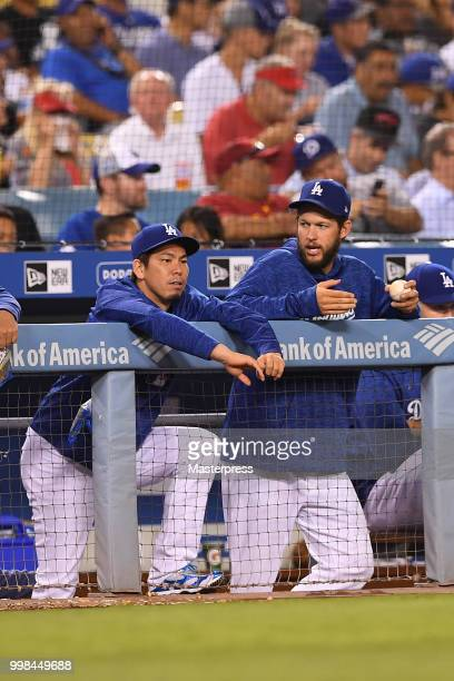 Kenta Maeda and Clayton Kershaw of the Los Angeles Dodgers talks during the MLB game against the Los Angeles Angels of Anaheim at Dodger Stadium on...