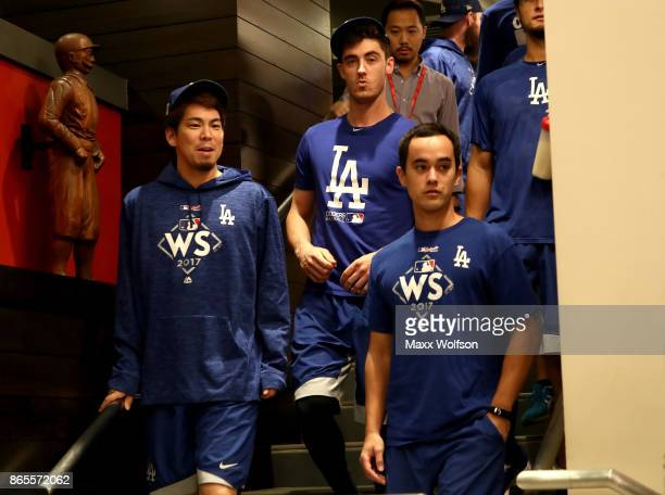 Kenta Maeda and Cody Bellinger of the Los Angeles Dodgers walk down the stairs ahead of the World Series at Dodger Stadium on October 23 2017 in Los...