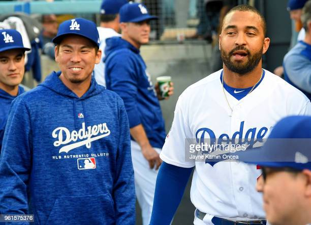 Kenta Maeda and Matt Kemp of the Los Angeles Dodgers in the dugout during the game against the Colorado Rockies at Dodger Stadium on May 22 2018 in...