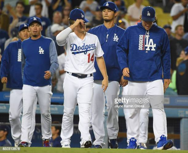 Kenta Maeda Enrique Hernandez Yu Darvish and Clayton Kershaw of the Los Angeles Dodgers walk on to the field after the game against the Chicago White...