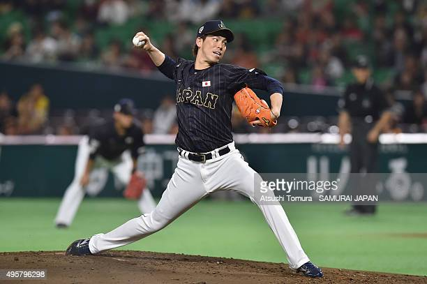 Kenta Maeda of Japan pitches in the bottom half of the first inning during the sendoff friendly match for WBSC Premier 12 between Japan and Puerto...