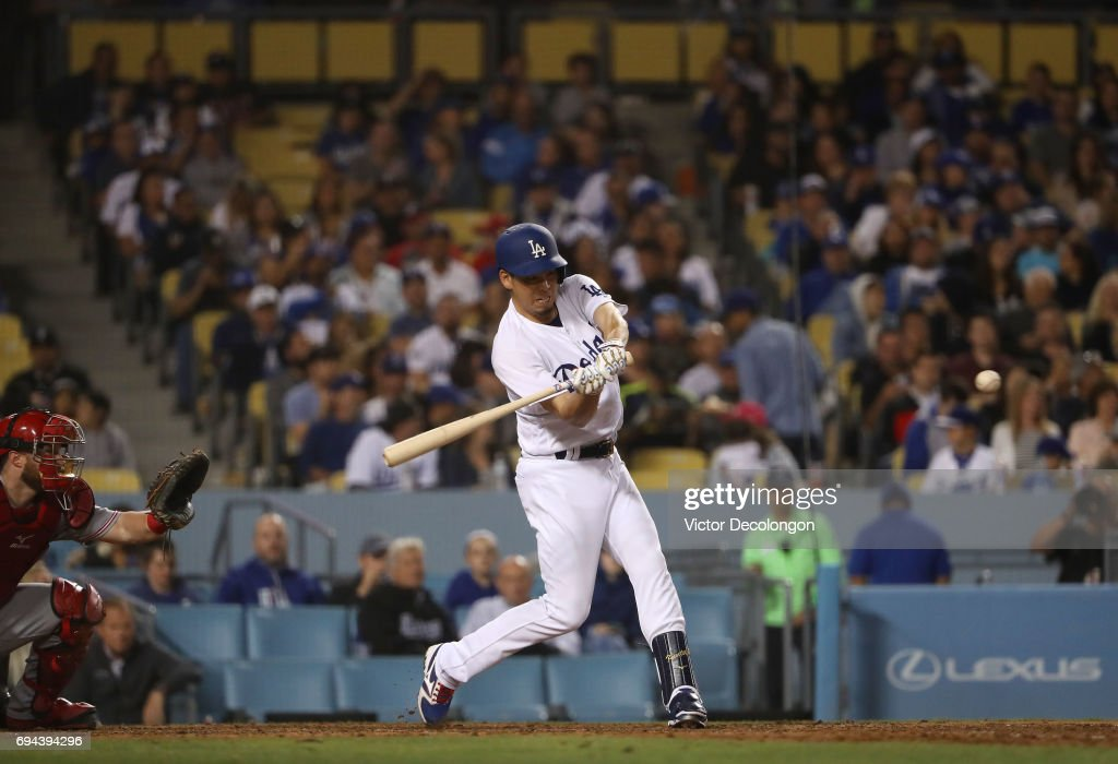 Kenta Maeda #18 of the Los Angeles Dodgers bats in the seventh inning during the MLB game against the Cincinnati Reds at Dodger Stadium on June 9, 2017 in Los Angeles, California. The Dodgers defeated the Reds 7-2.
