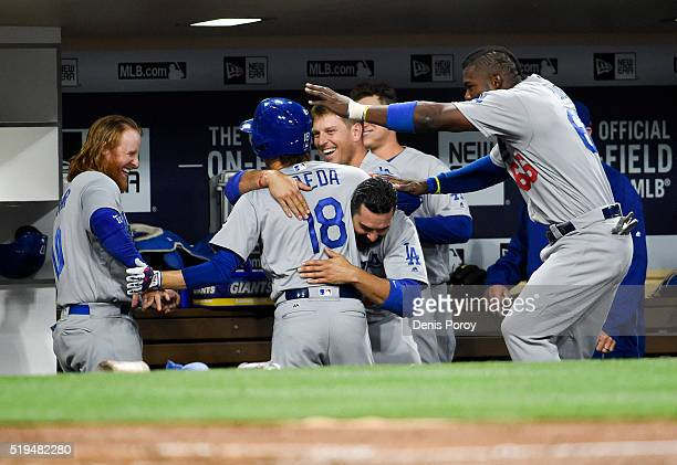 Kenta Maeda of the Los Angeles Dodgers celebrates in the dugout after hitting a solo home run during the fourth inning of a baseball game against the...