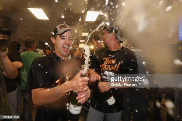 Kenta Maeda of the Los Angeles Dodgers celebrates in the locker room after defeating the Arizona Diamondbacks 31 to win game three of the National...