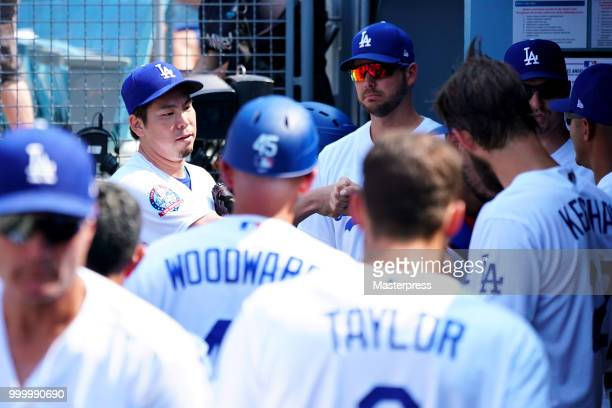 Kenta Maeda of the Los Angeles Dodgers celebrates with his team mates during the MLB game against the Los Angeles Angels at Dodger Stadium on July 15...