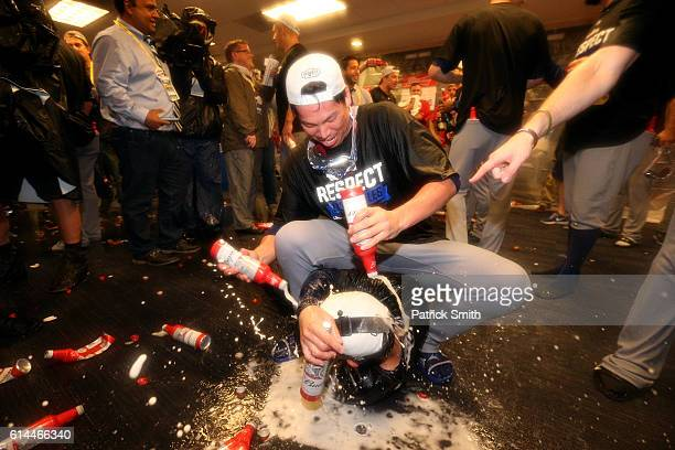 Kenta Maeda of the Los Angeles Dodgers celebrates with teammates in the clubhouse after winning game five of the National League Division Series over...