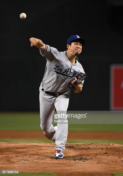 Kenta Maeda of the Los Angeles Dodgers delivers a warm up pitch against the Arizona Diamondbacks at Chase Field on August 8 2017 in Phoenix Arizona