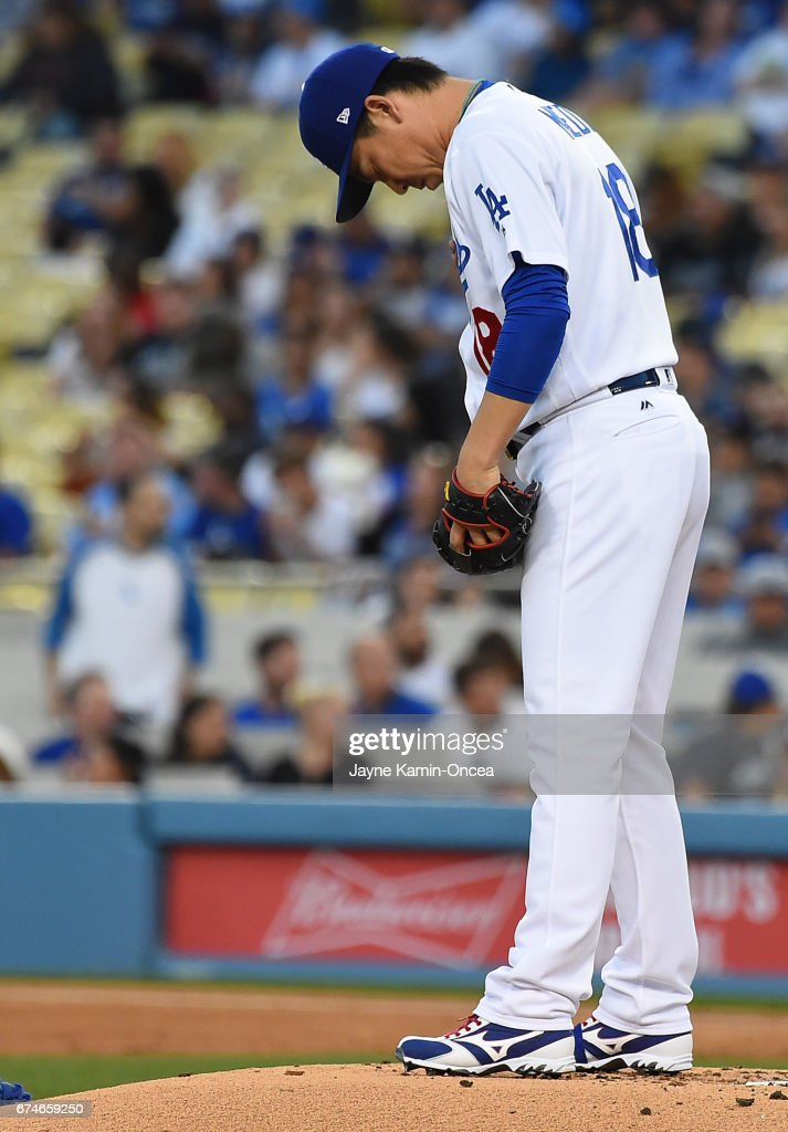 Kenta Maeda #18 of the Los Angeles Dodgers gets ready to start the second inning of the game against the Philadelphia Phillies at Dodger Stadium on April 28, 2017 in Los Angeles, California.