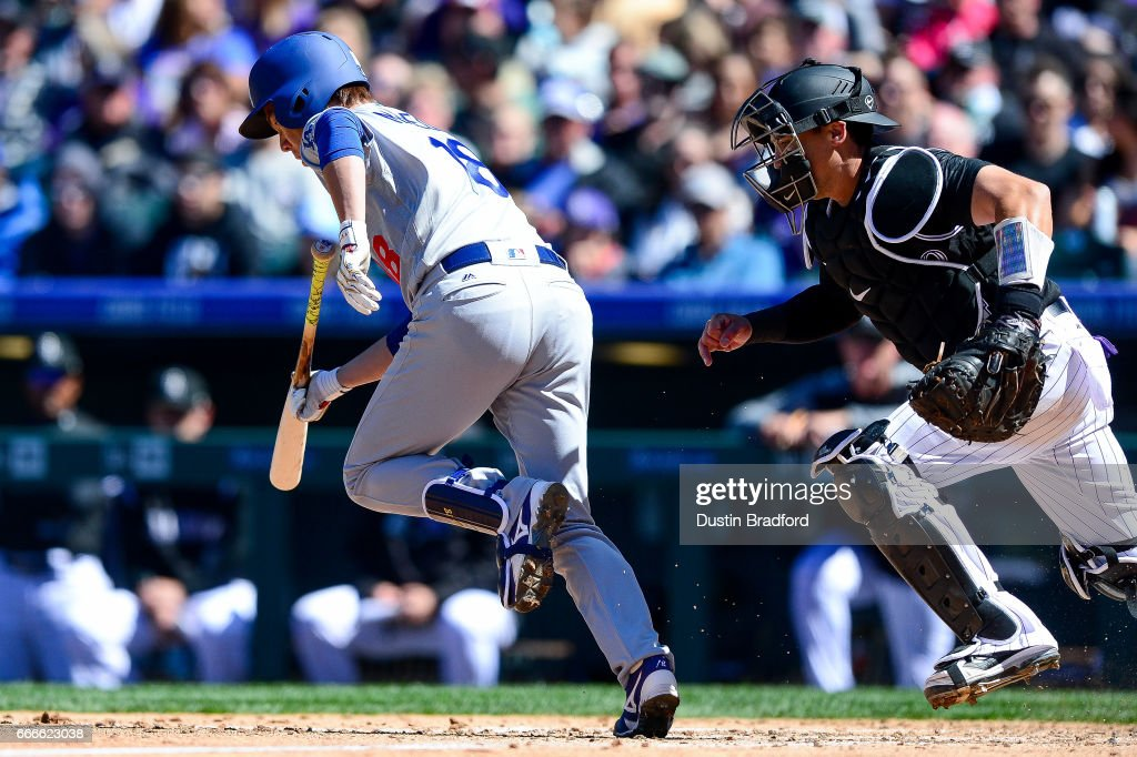 Kenta Maeda #18 of the Los Angeles Dodgers hits a sacrifice bunt in the fourth inning of a game against the Colorado Rockies at Coors Field on April 9, 2017 in Denver, Colorado.