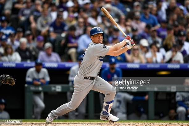 Kenta Maeda of the Los Angeles Dodgers hits a sixth inning double against the Colorado Rockies during the Colorado Rockies home opener at Coors Field...