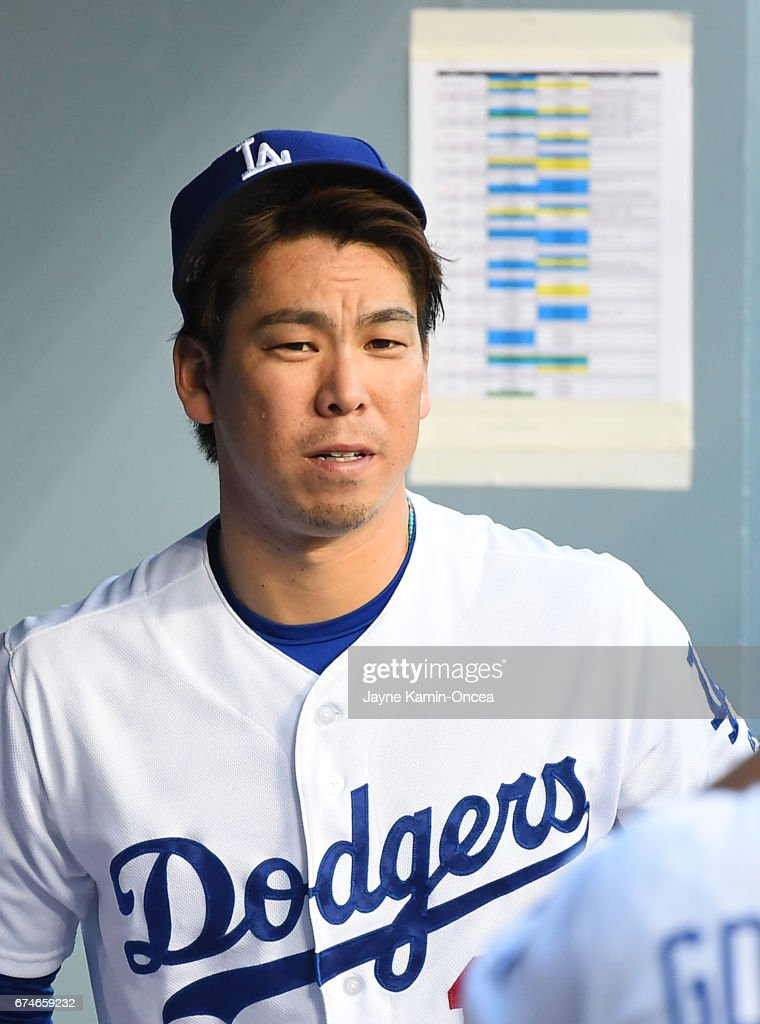 Kenta Maeda #18 of the Los Angeles Dodgers in the dugout before the game game against the Philadelphia Phillies at Dodger Stadium on April 28, 2017 in Los Angeles, California.