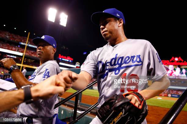 Kenta Maeda of the Los Angeles Dodgers is congratulated in the dugout after recording the final out of the fifth inning against the St Louis...