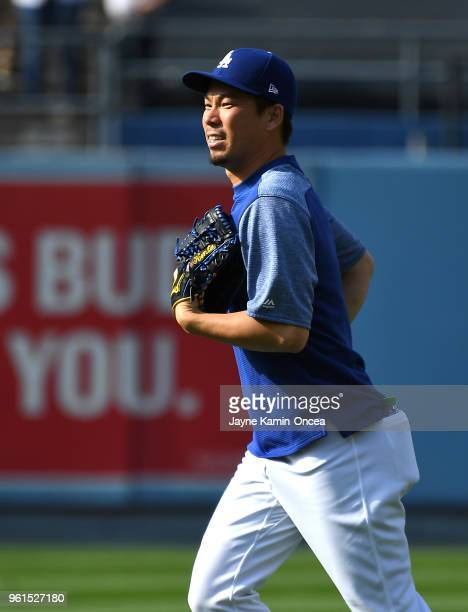 Kenta Maeda of the Los Angeles Dodgers jogs in from the outfield after batting practice for the game against the Colorado Rockies at Dodger Stadium...