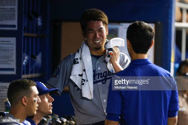 Kenta Maeda of the Los Angeles Dodgers laughs in the dugout against the Miami Marlins at Marlins Park on May 17 2018 in Miami Florida