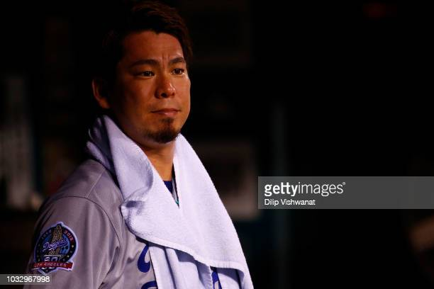 Kenta Maeda of the Los Angeles Dodgers looks on from the dugout after leaving the game against the St Louis Cardinals in the ninth inning at Busch...
