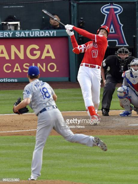 Kenta Maeda of the Los Angeles Dodgers pitches against Shohei Ohtani of the Los Angeles Angels in Anaheim California on July 6 2018 ==Kyodo