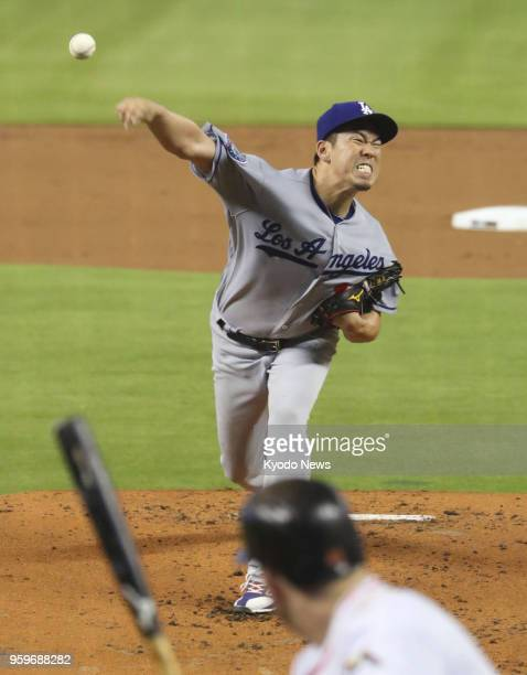 Kenta Maeda of the Los Angeles Dodgers pitches against the Miami Marlins in Miami Florida on May 17 2018 Maeda won his third game of the season as he...