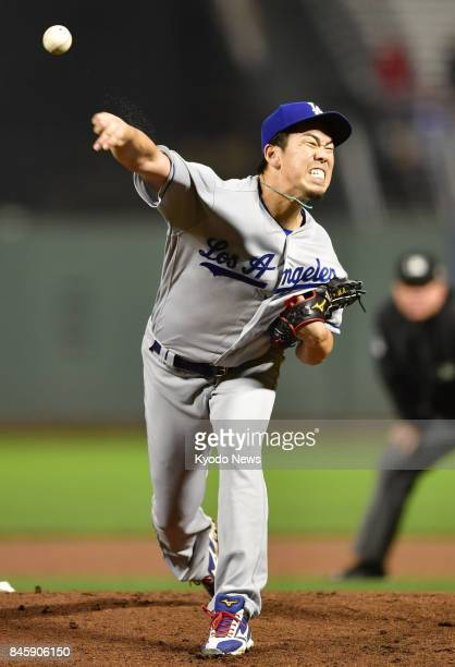 Kenta Maeda of the Los Angeles Dodgers pitches against the San Francisco Giants at ATampT Park in San Francisco on Sept 11 after a lengthy rain delay...