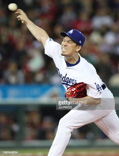 Kenta Maeda of the Los Angeles Dodgers pitches during fourth exhibition baseball game between the US Major League Baseball All Star team and the...
