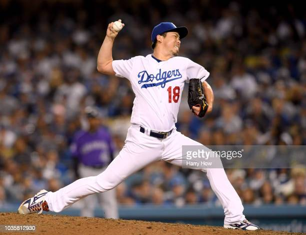Kenta Maeda of the Los Angeles Dodgers pitches during the eighth inning against the Colorado Rockies at Dodger Stadium on September 18 2018 in Los...