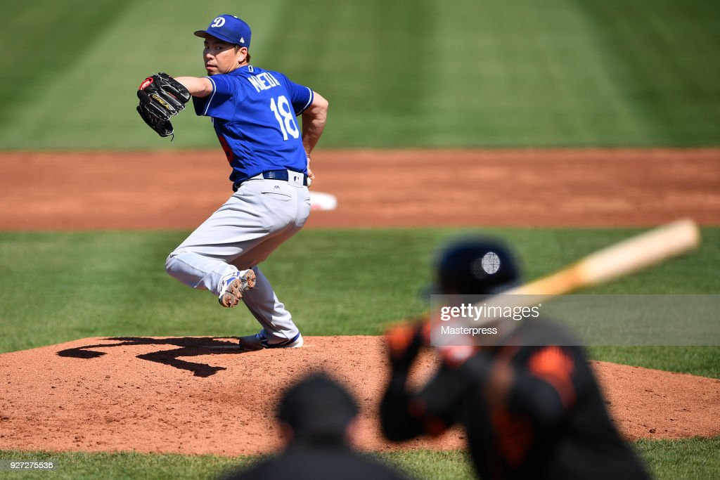 Kenta Maeda #18 of the Los Angeles Dodgers pitches during the game against San Francisco Giants on March 4, 2018 in Scottsdale, Arizona.