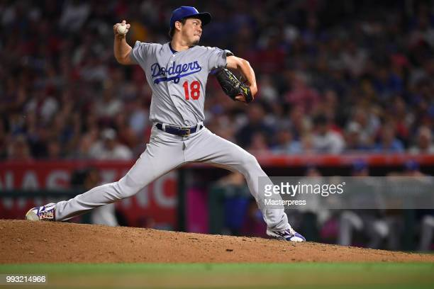 Kenta Maeda of the Los Angeles Dodgers pitches during the MLB game against the Los Angeles Angels of Anaheim at Angel Stadium on July 6 2018 in...