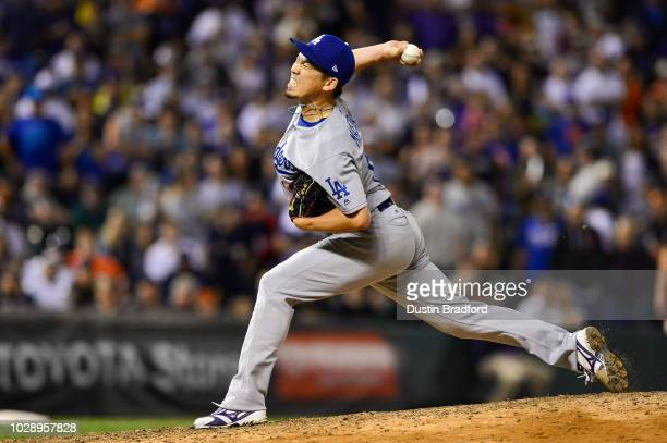 Kenta Maeda of the Los Angeles Dodgers pitches in a ninth inning with a runner on and one out against the Colorado Rockies at Coors Field on...